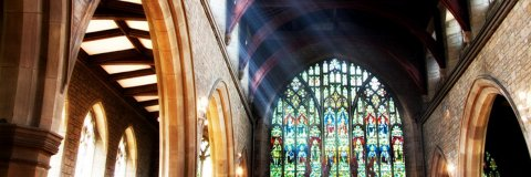 Rays of sunshine stream into the church building
